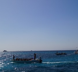View of boats with scuba divers at the Red Sea